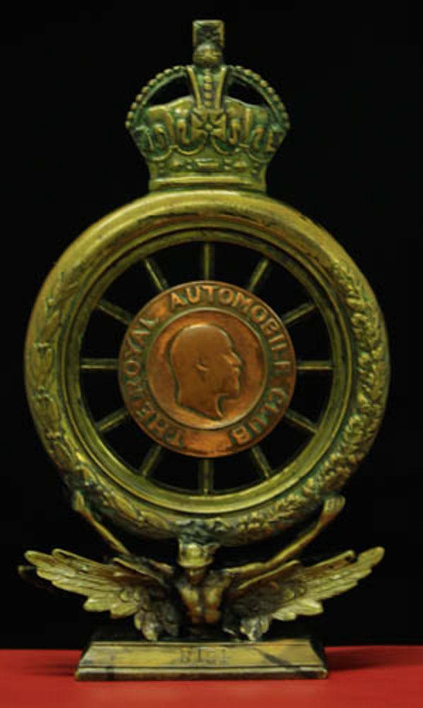 early brass hollow RAC badge