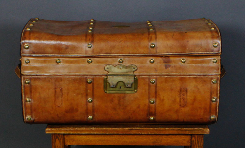 brass studded leather trunk